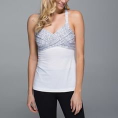 Lululemon wrap it up tank SZ4. More pictures to come. EUC, Comes with bra cups. Worn 4x and still very new looking! Comes from a pet free and non smoking home. lululemon athletica Tops Tank Tops