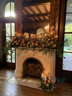Filling this mantle with cascading florals and floating candles to create the MOST romantic effect!