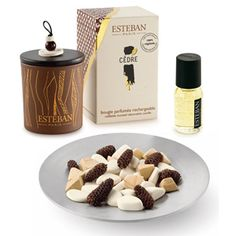 Esteban Paris Cedar Gift Set - Scented ceramic pieces and polished cedar stones in a fresh woody fragrance lay on a round silver dish, refreshed with oil as needed. Complimented with a matching decorative candle. A Rain Exclusive Gift Set - Complimentary gift wrap available.