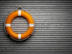 help: Lifebuoy attached to a wooden wall