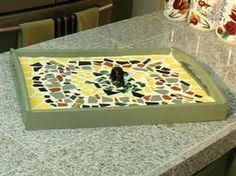 How to Make a Mosaic Serving Tray, Something we are going to do when we collect enough garage sale plates!