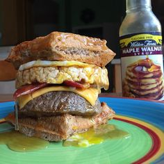 Homemade Bacon Egg & Cheese Breakfast Waffle Burger w/ a Caramel Corn Rice Cake hidden in the middle for the CRUNCH! Oh yeah @waldenfarmsinternational Maple Walnut syrup all over it because it's arguably the best syrup they have! It's unreal!!  Macros: 551 cals, 40g carbs, 18g fat, 52g protein  Man oh man that sweet and savory flavor BOMB  And if you want some free @waldenfarmsinternational, make sure to participate in the massive giveaway ive partnered with them on where ...
