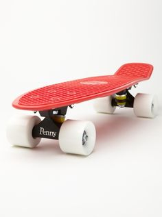 Penny Skateboard - Roxy. Would love this in either the Green/Orange/Yellow or the Orange/Blue/White color schemes.