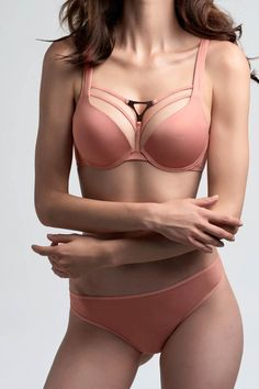 The Triangle collection from Marlies Dekkers emphasises strong and sculpted feminine silhouettes and has decorative metal triangle detailing. The Marlies Dekkers Triangle This thong has narrow (4cm) wide side panels and is a hipster design with the dazzling triangle metal detailing at the back. Match this brief back with any of the Marlies Dekkers 'Triangle' bras for a super sexy set.   Triangle Thong by marlies dekkers. Clothing - Lingerie & Sleepwear Canada