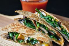 Yum...these are healthy quesidillas on wheat tortillas filled with cheese,spinach,mushrooms, onions and chicken.