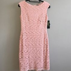 LAUREN by Ralph Lauren lace DRESS Sheath style dress NEW with TAGS never worn perfect condition. Completely lined in a beautiful rose pink with Gorgeous LACE overlay.  Back zip. Sleeveless. Hits at knee length Great spring dress for any affair. Ask for measurements. Lauren by ralph lauren Dresses Midi