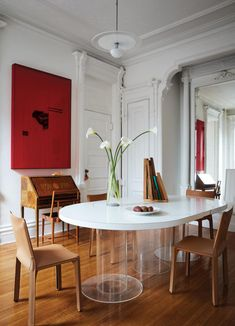 AHEAD OF THE CURVE In de Cárdenas's dining room, a Paul Rudolph table and Mario Bellini Cab chairs meet a 1930s Swedish secretary. The mixed-media work on the wall is by Isabelle Cornaro.
