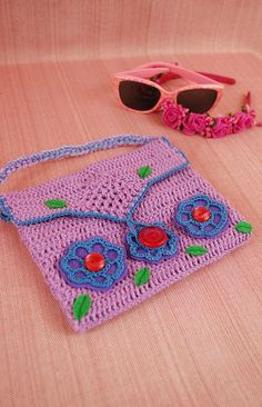 All parts of this kids' crochet bag are handmade. I use cotton yarn, acrylic yarn, linen fabric, felt and buttons for making this cute small girl's handbag. This pink kids' handbag is suitable for carrying of any important stuff: small toys or books, sunglasses, candies, etc. This wonderful custom bag for little princesses has got short crochet handle. You can use this item as a bag for games or a lovely summer bag. Have you ever seen a better and more beautiful flower girl gift? I think, no…