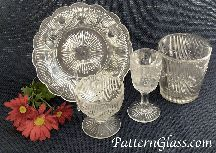 """By the late 1840s, the glass pressing process had improved. As with the earlier Lacy Glass, these """"better"""" pieces were made of Flint Glass (plate, egg cup, goblet, and tumbler in Bellflower pattern c1850)"""