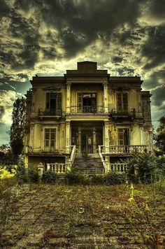 Dark House – Thessaloniki, Greece: This gothic-style building in Greece used as a funeral home then abandoned. Note the creepy iron bars over the doors. Abandoned Buildings, Old Abandoned Houses, Abandoned Places, Old Houses, Abandoned Castles, Spooky House, Creepy Houses, Spooky Places, Haunted Places