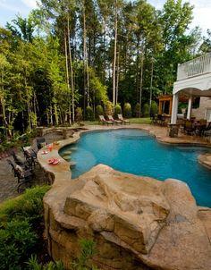 Stunning backyard and pool with swim up bar area