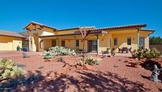 New Listing! 3600 Red Rock Loop Rd. Sedona, Az 86336/ MLS: 512210 This stunning, versatile, custom home sits on 2.08 glorious acres bordering us national forest land with sweeping panoramic red rock views, including direct views of world famous cathedral rock.