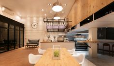 Café Murasaki initiated by the client's proposal, which planed to renovate a pair of row houses to be the café.