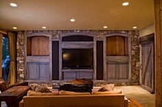 Awesome built in bookcases with stone accent