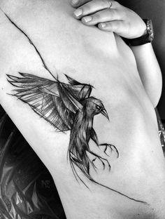 raven tattoo on rib