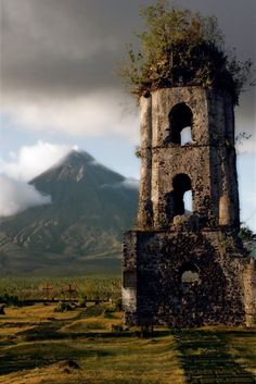 The ruined belltower of the church of Cagsawa, by the Mayon Volcano; Bicol…
