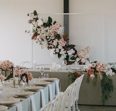 Bridal table florals, love the idea and would want to put some framed photos around the flowers