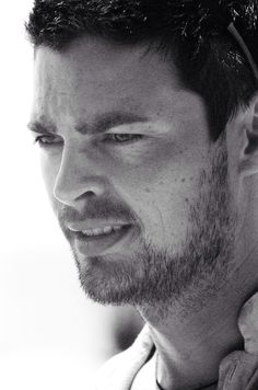 Karl Urban, as Kirill in The Bourne Supremacy (at least I'm pretty sure about that). He wears scruffy very well. :-)
