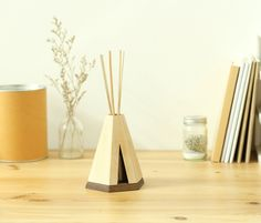 Teepi : Aromatic Diffuser € 41.00 Inspired from the traditional native American Indian's tent, Teepi will spread an aromatic mood through out your room!  The design also incorporated a tiny door for you to peek inside and see the magic behind its mystic aroma. Contact sales@qualyandco.com for more wholesales information and worldwide brand distribution.  #pana #panaobjects #teepi #diffuser #aroma #therapy #mood #wood #spa #sense #relax #designgifts #creative