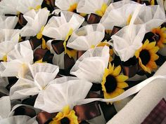 Seed packets tied with ribbon and sunflower.  See more seed packet wedding favors and party ideas at www.one-stop-party-ideas.com