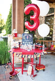 A Backyard BBQ Birthday Party with custom aprons & chef hats, candy filled seasoning shakers, grill topped cake, hamburger piñata, 'EAT' centerpiece & more..