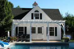 traditional pool house with pergola