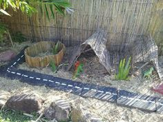 "Dinosaur caves in the garden at Raylene's Family Day Care ("",)"