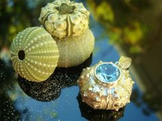 Sterling silver cast sea urchin set with brilliant cut blue topaz