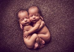 newborn photographer, baby twins hugging... omg this is the sweetest twin pose ever! I want a do over on my girls baby pictures! :(