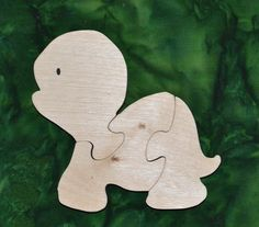 """This Turtle Puzzle is fun to do and assists in the development of small motor, hand-eye coordination, visualization and problem solving skills all of which are important in the process of reading.    Our puzzles are made from toy quality 1/2"""" Baltic birch plywood and are rubbed with AFM Naturals, an oil wax finish that is completely safe. Dimensions: 5.25"""" high, 5.75"""" long Handmade Wooden Toys, Baltic Birch Plywood, Problem Solving Skills, Wooden Puzzles, Bella, Turtle, Dinosaur Stuffed Animal, Wax, Reading"""