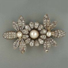 A diamond and pearl, flower and bee brooch,