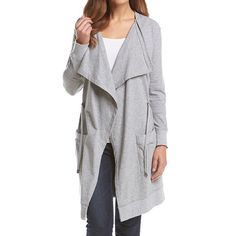 🆕Michael Kors Gray Drawcord Drape Cardigan🆕 With draped detailing and a drawstring waist this cardigan offers a lesson in athleisure-chic. Crafted from a light jersey blend it's finished with patch pockets and an extended hem. Complete a sport-luxe statement by teaming it with distressed denim and sneakers. Color: Pearl Heather(Gray); Material: Jersey. MICHAEL Michael Kors Tops