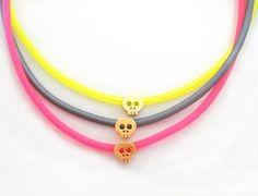 3 Neon Rubber Bracelets With Tiny Matt Yellow Gold Plated Skulls