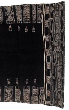Africa | Detail from a shawl, Bakhnuq, from Tunisia | Wool and cotton; the black ground divided in the centre by a single stripe flanked by a lozenge motif, with finely woven mushroom brown borders of geometric panels and bands, fringes to either end