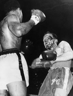 American boxer and world heavyweight champion Muhammad Ali throws a long right to British challenger Henry Cooper's injured left eye in the sixth round of their world heavyweight championship fight at Highbury Stadium, London. Ali retained his title after the referee George Smith stopped the fight shortly after the sixth round began, due to Cooper's eye injury.
