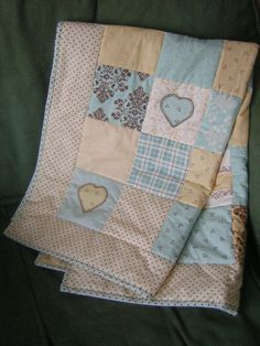 Patchwork quilt, baby quilt, tummy-time, play mat. Hand-embroidered, appliqued hearts.