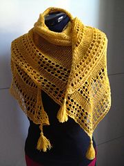 Ravelry: Light and Up a free knitting pattern by Caroline Wiens. Love the tassels on the points of the shawl!