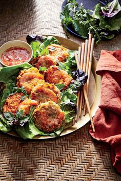 Sweet Potato and Shrimp Cakes with Nuoc Cham | I consider this dish a modern Vietnamese cook's interpretation of a classic. If you can find white sweet potatoes, use them--they're drier and less sweet than their orange cousins, but traditional sweet potatoes will work just fine, too. Place the dipping sauce in a bowl surrounded by the lettuce and herbs so guests can build their own lettuce wraps as they like. If your family enjoys crab cakes or salmon cakes, break out this recipe to expand…