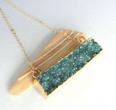 A personal favorite from my Etsy shop https://www.etsy.com/listing/533379911/evergreen-druzy-bar-gold-filled-necklace