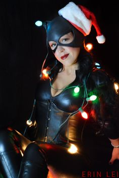 Catwoman: Red Star Cosplay | Photography: Project-Nerd Cosplay | Catwoman has been my go-to costume, so it seemed only right to do a holiday shot. What do cats do? They get tangled in the lights #cosplay