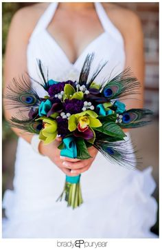 Peacock Wedding Ideas The turquoise ribbon accents really make the green orchids look bright. The purple lizianthus is such a rich color. I like the way the brunia berries pop, but I think tiny white Euphorbia flowers that bloom in may would be the perfect hint of white if your wearing a white dress.