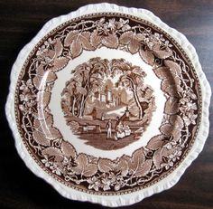 Decorative Dishes - (http://www.decorativedishes.net/brown-transferware-exotic-castle-couple-dog-leaves-large-plate/)