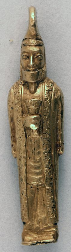 Gold statuette of bearded man; cast and chased; thin face with small straight…