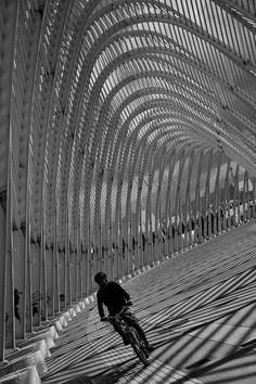 Biking under the Arch (by architect Santiago Calatrava) outside the Athens Olympic Stadium