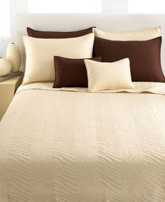 against an olive or darkish gray wall...michael kors zebra quilt
