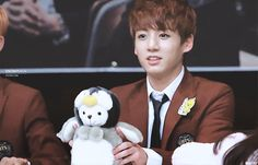 Kookie <3 - Whatever that is he's playing with, I want it!