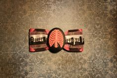 Death Rib Cage Hair Bow Black and Pink by RiotGearHairBows on Etsy, $8.00