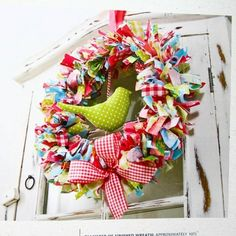 Colorful ribbon or strap fabric wreath. Ribbon Crafts, Wreath Crafts, Diy Wreath, Fabric Crafts, Sewing Crafts, Rag Wreaths, Scrap Fabric, Book Wreath, Cute Crafts