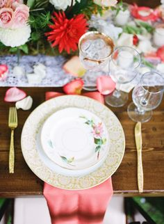 Pretty Place Setting (with the added touch of rose petals). See the Real Wedding on SMP: http://www.StyleMePretty.com/2014/03/04/coral-wedding-at-mountain-magnolia-inn/ D'Arcy Benincosa Photography