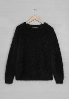 Angora jumper to wear with; 1. leather trousers and stilettos for an evening look 2. pencil skirt, black tights and boots (ankle or knee high) 3. Blue jeans and trainers 4. Blue jeans and boots  Very cosy but quite itchy